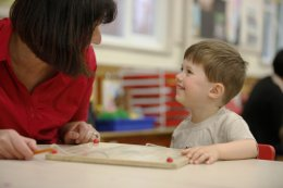 Child learning with nursery assistant in Cookham